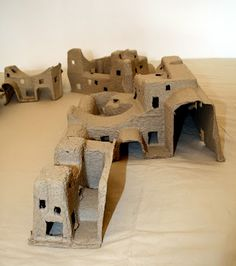 Houses made from packing material---I LOVE doing this!!!! We have made TOWER of BABEL....Solomon's Temple and Bible Time Cities!!!