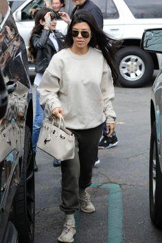 Kourtney Kardashian wearing Adidas x Kanye West Yeezy 350 Boost Sneakers in Oxford Tan and Hermes Birkin Bag