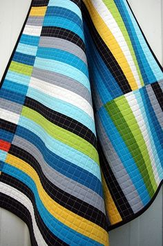Finally a masculine quilt I like! Love the colors for the boys older room look. From Red Pepper quilts...love her.
