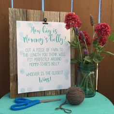 Belly Size Game is a fun and easy self guided game guests can play during the shower. Set up a table with our print at home sign, some scissors and yarn. During the shower remind your guests to visit the table before measuring mommy to be's belly.