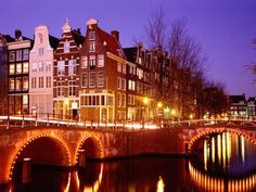 Canals of Amsterdam, Amsterdam is definitely another stop.