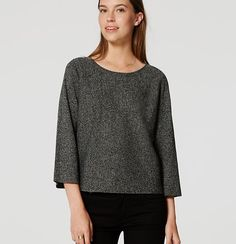 Chic and easy, this sweater gets smart with a speckled tweed-effect texture. Round neck. Wide 3/4 sleeves.