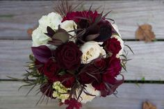 Color/Bride Inspiration--this is a bit heavy on the wispy dark foliage but overall is heavy on the beautiful burgundy/plum tones accented with the whites/creams; I do like the accent of the darker foliage, the one with the rounded leaves is smokebush which is beautiful
