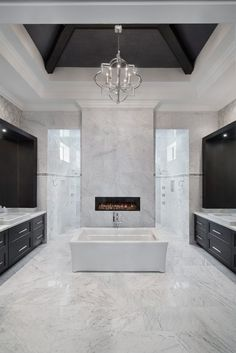 Coastal Contemporary - 2015 Golf Magazine Dream Home - Talis Park Naples, FL - Weber Design Group  Master bath with luxurious soaking tub, fireplace and carwash style shower.