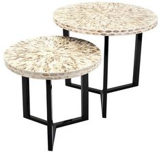 Enjoy the Pavati Shell Tables at your next beach party, two round side tables are uniquely crafted of a capiz shell mosaic and each feature a modern style black metal base.
