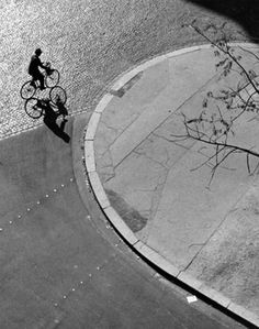 André Kertész Paris (man on bicycle), 1948.  Kertesz was a genius of photography.