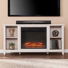 Parkdale Electric Fireplace TV Stand in White - Southern Enterprises your home with warmth. Light up your space with this electric fireplace media stand, specifically designed with the first time owner in mind. Open storage with adjustable shel Fireplace Media Console, Fireplace Shelves, Faux Fireplace, Fireplace Ideas, Tv Stand With Fireplace, Limestone Fireplace, White Fireplace, Fireplace Design, Electric Fireplace Entertainment Center