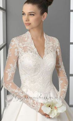 Absolutely love this. I think sleeves can be so elegant and sexy but still conservative. Gotta leave something for the honey moon, ya know?