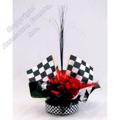 Race Quick Wrap Centerpiece is inexpensive, quick and easy. Choose 3 colors to pair with the black and white checkered flags.