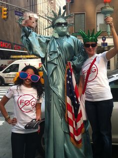 Members of the Optifog team posed with Lady Liberty in New York