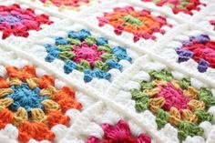 Granny Square Afghan with one round of white for each block. Original pattern from attic24 here: http://attic24.typepad.com/weblog/summer-garden-granny-square.html
