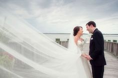 Capturing the veil as it takes flight in the wind is photographic gold. Mollie Tobias Photography, Virginia Wedding Photographer.