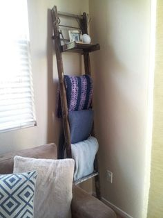 Wood ladder to hold blankets & shelf to hold picture frame : )