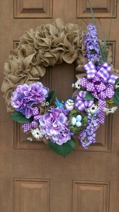 Ruffle burlap wreath with spring shades of purple while mother blue bird over looks her nest and eggs