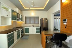 Guest Living Space Design - Wooden Finished Flooring and U shape sofa settings. Kerala home design , Indian Style L Shaped Modular Kitchen, U Shaped Sofa, Cocinas Kitchen, Kerala House Design, Indian Homes, Buying A New Home, Home Remodeling, Living Spaces, Interior Design