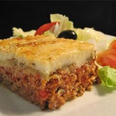 """""""Here is a great recipe for moussaka, a Greek dish. It includes sliced eggplant baked in a ground beef sauce and then smothered in a thin white sauce."""" Ingredients 3 eggplants, peeled and cut lengthwise into Greek Recipes, Meat Recipes, Cooking Recipes, Recipies, Meat Meals, Fun Recipes, Water Recipes, Vegetarian Recipes, Sauerkraut"""