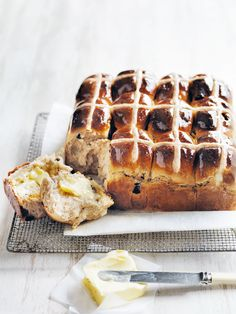 Classic hot cross buns by Donna Hay  This is the best one for US bakers I think.  Not by weight and very straightforward. For mix spice 2 teaspoons of pumpkin spice that has Nut cardamom clove and ginger (trader Joe's) and 1 teaspoon of all spice (Jamaican pepper or Pimento)
