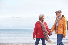Senior Couple Hold Hands As They Walk Along Shoreline On Winter Beach Vacation by monkeybusiness. Senior Couple Hold Hands As They Walk Along Shoreline On Winter Beach Vacation Winter Beach, Hold Hands, Inspiration Quotes, Hold On, Walking, Illustrations, Vacation, Couples, Vacations
