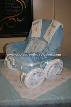 Homemade Carriage Diaper Cake: I made this Carriage Diaper Cake for my first nephew Zachary, who was born on Valentine's Day 2010. It was made from a storage basket, large blanket, ribbon,