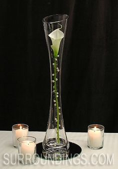 absolutely beautiful. but i think i'll try using rhinestones instead of the pearls, and have various sizes of vases.  Pearled calla lily in Maria vase candle centerpiece