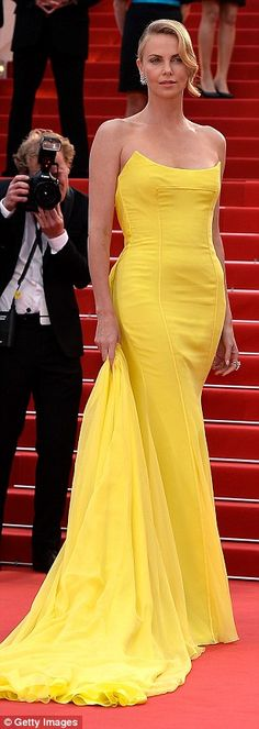 Wow factor: The South African born actress chose a super bright strapless gown for her big night, keeping her accessories to a minimum to keep the attention on the gorgeous gown