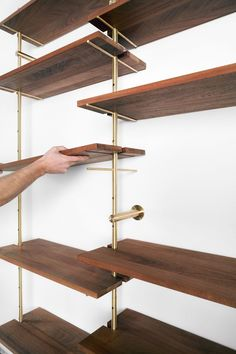 Brass Rail Shelving by Ryan Taylor for Object/Interface (Design Milk) Wall Mounted Shelves, Wood Shelves, Brass Shelving, Dark Wood Bookcase, Shop Shelving, Adjustable Shelving, Storage Shelves, Home Furniture, Furniture Design