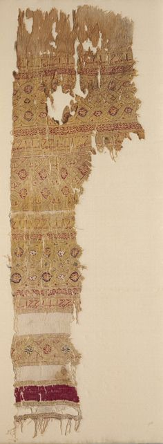 Fragment of a Tiraz-Style Textile, 1100s Egypt, Fatimid period, 12th century tabby ground with inwoven tapestry ornament; linen and silk, Overall: 55.00 x 17.50 cm (21 5/8 x 6 7/8 inches).
