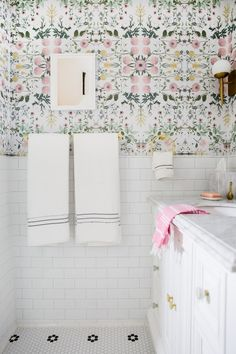 Check out this beautiful DIY bathroom with pink floral wallpaper, brass accents, a round mirror, marble vanity, subway tiles. It's a girly decor dream! For a small bathroom it sure is big on style! Silver Bathroom, Small Bathroom, Pastel Bathroom, Bathroom Colors, White Bathroom, Modern Bathroom, Budget Bathroom, Bathroom Interior, Bathroom Ideas
