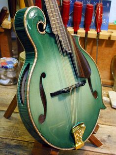 Another take on the green mandolin (with soundholes!) I'm aiming for this sort of light teal, but not sure if I can pull it off as well...this Monteleone is a thing of beauty