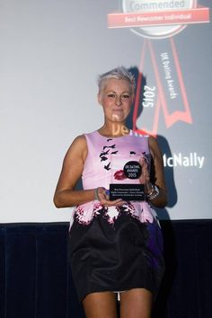 Matchmaker Academy Graduate Denise Mcnally collecting her award for runne rup at the UK Dating Awards