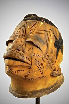 Very fine Lipiko' mask.Makonde – Mozambique. Light balsa wood,yellow pigments and hair with fine striking facial decorations.Possibly from the same hand as the 'Master of the Abstract Coiffeur' who's signature was to carve the mask with abstract hair designs to one or both sides.The mask came from a private Dutch collection.Early part 20th century. £5500