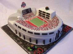 Congrats to the National Champions!  Ohio State University Stadium in fondant, cereal treats, and icing for a truly unique Wedding Cake.  #footballwedding #stwdotcom