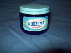 Noxema jar with original paper label. The label does have some discoloration and is puckering slightly in spots. The jar is in good