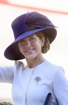 Stunning: In October she donned a navy blue hat to attend the opening of Parliament at Chr...