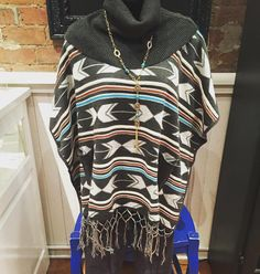 More New!!! Love this Aztec Poncho!!! Aztec cowl neck poncho- $44 Grey joggings- $36 Statement necklace- $21.95  #madisonsbluebrick #downtownhotsprings #fallfashion #poncho #jeggings #shoplocal