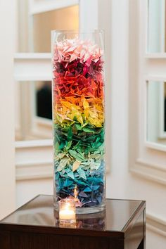 Opt for paper cranes instead of flowers as your centerpieces for a colorful and fun touch to your wedding