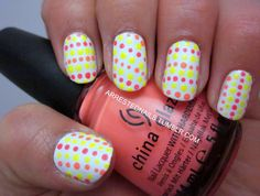 great way to add some variety to a simple polka dot mani