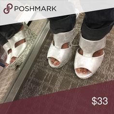 """NWT Jennifer Lopez wedges They are shimmery and have braided wedges. The heel is 4-7/8"""". Smoke free house. Jennifer Lopez Shoes Wedges"""
