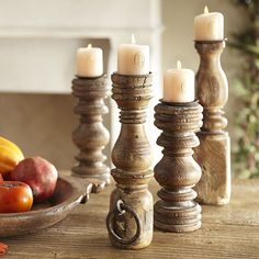 Reclaimed Wooded Candlesticks  I made some like these from spindles and bed frame parts