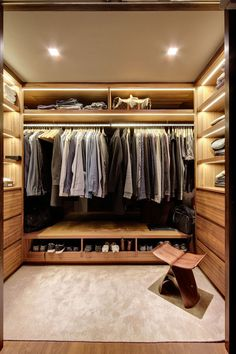 15 Examples Of Walk-In Closets To Inspire Your Next Room Make-Over // This walk-in closet has every shelf lit with its own strip of lighting.