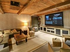 When+it's+time+to+watch+a+movie+in+this+room,+the+projector+drops+out+of+the+ceiling+and+the+screen+drops+down+from+a+reclaimed+beam+in+the+ceiling.+The+control+system+allows+the+house+sources+to+be+shared+in+the+media+room+along+with+a+local+Blu+Ray+player.