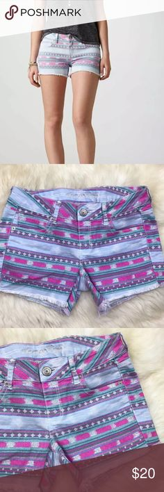 "American Eagle Stretch Tribal Frayed Denim Shorts In excellent used condition, color appears a bit brighter due to lighting. Materials are 71% cotton, 27% polyester & 2% spandex. Stretchy. Measurements are 10"" in length, 8"" front rise, 3 1/2"" inseam, & 16"" across waist. 5 pockets. Zipper on front center with button closure. No distressing. Fringing on bottom hem & embroidery on back pockets. ❌NO TRADES OR PAYPAL❌ American Eagle Outfitters Shorts Jean Shorts"