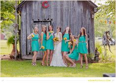 Seriousness is overrated. Teal Bridesmaids Dresses. Sunflower bouquets. Bridal Party Posing. Fun Wedding Photos.