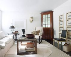 Darryl Carter: A sofa and wing chair by Lee Industries and a Louis XVI side chair surround a custom-made cocktail table in the family room; the corner cabinet is a family heirloom,