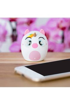 A portable pocket-sized Bluetooth speaker that plays 3-4 hours of music with each charge featuring a unicorn design, built-in microphone for taking and receiving calls, a wrist strap, and a power button that doubles up as a shutter remote for taking selfies from a distance.