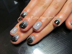 Black Shellac with a rainbow glitter done in a fade (glitter fade) with a rockstar accent.  Nail Artist: Lisa Rattai  Twitter: @beautynthebooks  Instagram: @beautyandthebooks