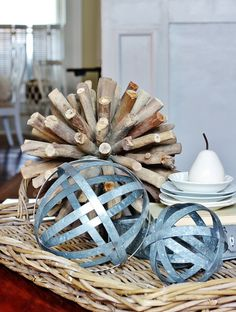 Decorating With Trays.  I love the metal spheres.  And I really like the white ceramic pear.  I wonder if I could pull off a close enough look with spray paint and a pear from the dollar store?