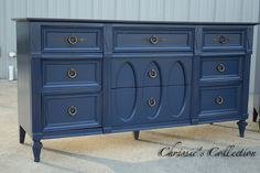 "9 drawer dresser in Navy Blue with a distressed finish and Antique Walnut top. Measures 64""x19"" and 33""t. $465. Currently available to be seen in the warehouse. Call/text 256-658-6328 if you would like to come have a look. Thanks!"
