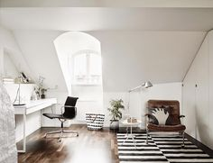 eames office chair, black and white striped rug