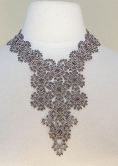 Exquisite, hand tatted statement necklace, with a truly regal presence.